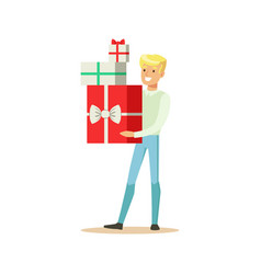 happy young man standing and holding gift boxes vector image