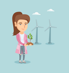 Caucasian worker of wind farm holding small plant vector