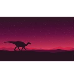 Landscape Iguanodon silhouettes vector image vector image