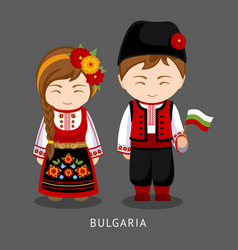 Bulgarians in national dress with a flag vector