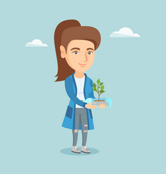 Woman holding plant growing in a plastic bottle vector