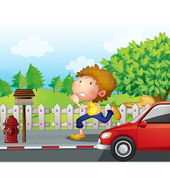 A boy running at the street with a mailbox vector