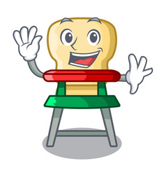 waving cartoon baby sitting in the highchair vector image