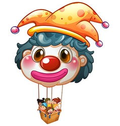 A big clown balloon with kids in the big basket vector image vector image