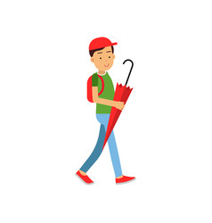 boy with backpack walking with red umbrella vector image