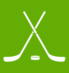 crossed hockey sticks and puck icon green vector image