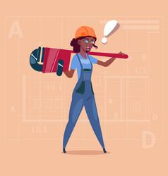 Cartoon female builder wearing uniform and helmet vector