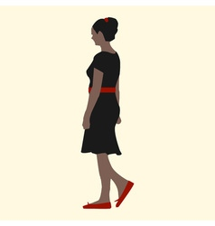 A girl in a black dress red shoes belts and hair vector