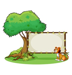 A tiger sitting at the right side of a signage vector