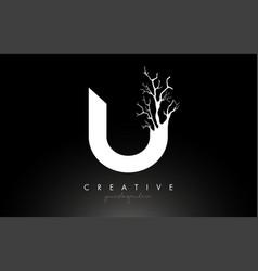 Letter u design logo with creative tree branch u vector