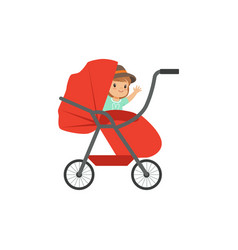 Cute little kid sitting in a red baby pram safety vector