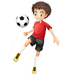 A young man playing football vector image vector image