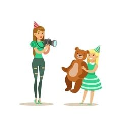 Woman Taking Pictures With Girl And Teddy Bear vector image vector image