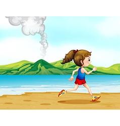 A girl running along the seashore vector image