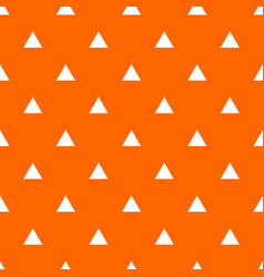 Tile pattern with white triangles on orange vector