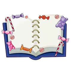 A book surrounded with sweet candies vector image vector image