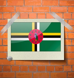 Flags Dominica scotch taped to a red brick wall vector