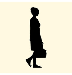 a silhouette of a girl with a bag walks in the vector image