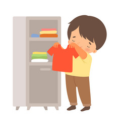 Little boy folding his clothing in wardrobe vector