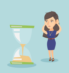 desperate business woman looking at hourglass vector image vector image