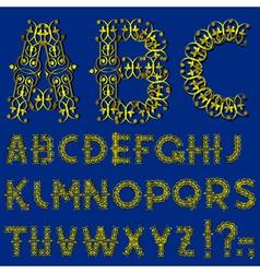 Swirly golden alphabet vector image