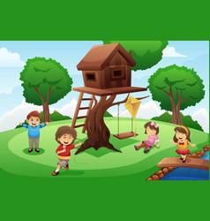 kids playing around tree house vector image
