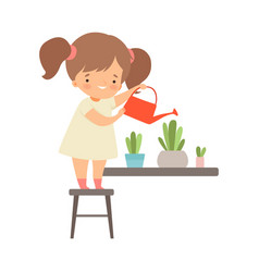 Little girl standing on chair and watering flowers vector