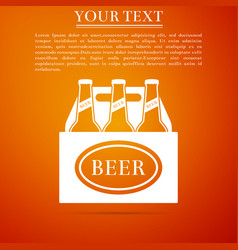 pack of beer bottles icon on orange background vector image