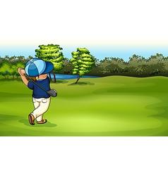 A boy playing golf vector