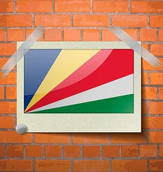 Flags SEYCHELLES scotch taped to a red brick wall vector