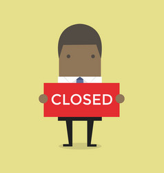 african businessman hold a sign closed in his hand vector image