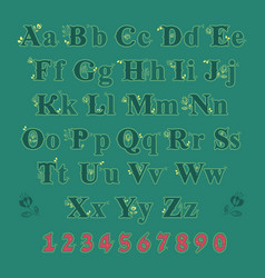 green alphabet with yellow floral decor vector image vector image