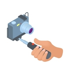 Hand holding selfie stick with camera icon vector image
