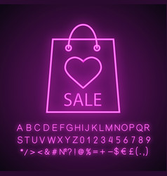 shopping bag with heart neon light icon vector image