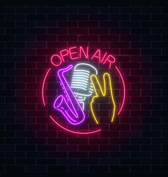 Neon open air sign with microphone saxophone and vector