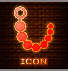 Glowing neon anal beads icon isolated on brick vector
