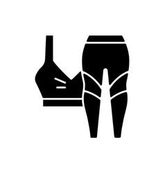 Workout clothes black glyph icon vector