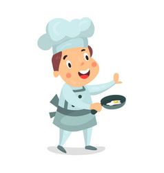 cute cartoon little boy chef character holding a vector image
