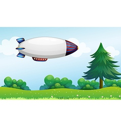 An airship above the hills vector