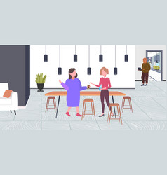 two girls discussing during meeting break vector image