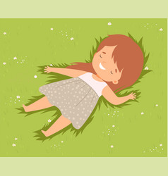 Happy smiling girl lying down on green lawn cute vector