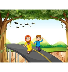 Muslim couple crossing a bridge vector image
