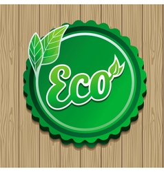 eco label - green sticker on wooden backgro vector image vector image