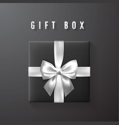 Black gift box with white silver bow and ribbon vector