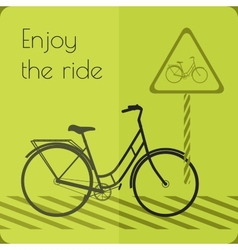 gray shape bicycle on road with road sign vector image