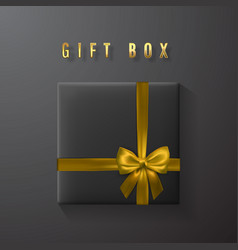 Black gift box with golden bow and ribbon top vector