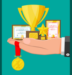 trophy and awards collection in hand vector image