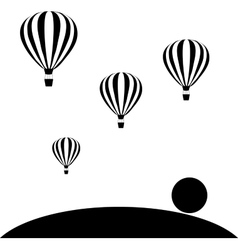 Aerostats flying in sky at sunset vector