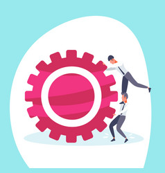 two businessmen pushing cogwheel hardworking vector image