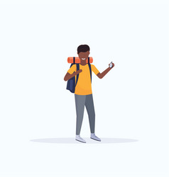 Man tourist hiker with backpack holding compass vector